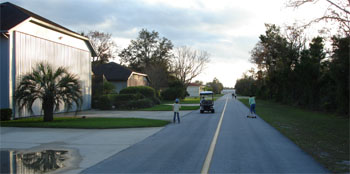 Golf Carts, Rollerblades and Bicycles share a lone taxiway during a weekend afternoon at Spruce Creek